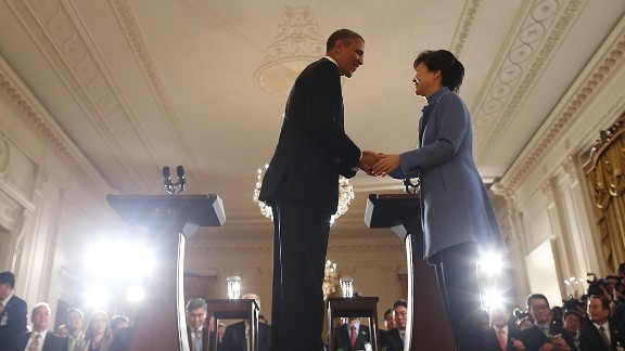 Park shakes hands with US President Barack Obama during a White House news conference in May 2013.
