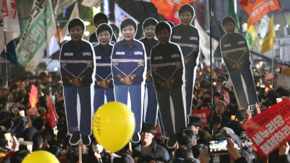 After the corruption allegations surfaced, demonstrators carry cutouts of Park during a December 2016 rally calling for her to step down.