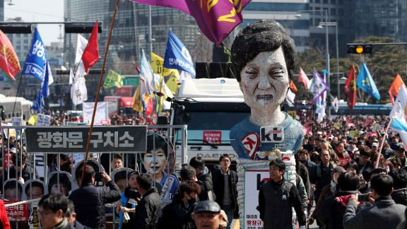 Anti-Park protesters carry an effigy of the ousted president as they march toward the Blue House in March. Stripped of her immunity, Park is now liable to prosecution and must vacate the Blue House.