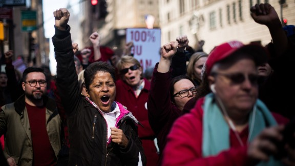 Gloria Brown cheers during a rally in New York for International Women