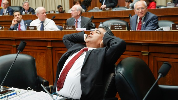 After working through the night, US Rep. Tony Cardenas stretches Thursday, March 9, while members of the Energy and Commerce Committee argue the details of a health care bill introduced by top House Republicans.