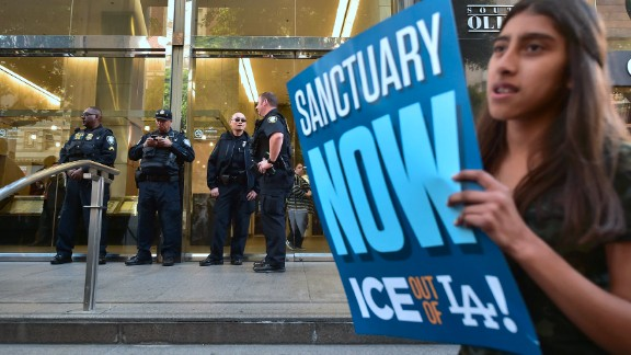 """Protesters gather outside the Los Angeles Immigration Court building after a rally on Monday, March 6. The rally was held a few days after <a href=""""http://www.cnn.com/2017/03/03/us/california-father-ice-arrest-trnd/"""" target=""""_blank"""">the arrest of Romulo Avelica-Gonzalez,</a> an undocumented immigrant who was detained by immigration agents as he drove his teenage daughter to school. Immigration and Customs Enforcement said in a statement that he was arrested because he has """"multiple prior criminal convictions, including a DUI in 2009, as well an outstanding order of removal dating back to 2014."""" Since President Trump's inauguration, scores of unauthorized immigrants have been detained and deported under his administration's hard-line immigration stand."""
