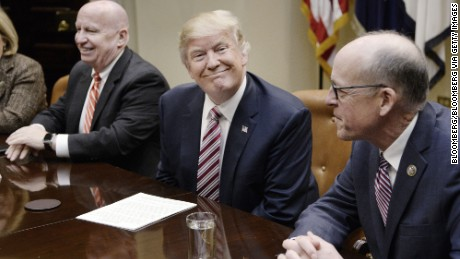 U.S. President Donald Trump, center, smiles as Representative Greg Walden, a Republican from Oregon, right, and Representative Kevin Brady, a Republican from Texas, sit during a discussion on health care in the Roosevelt Room of the White House in Washington, D.C. U.S., on Friday, March 10, 2017.