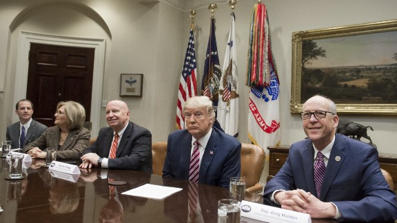 US President Donald Trump holds a meeting with US House Committee Chairmen, including Representative Diane Black (2nd L), Republican of Tennessee and House Budget Committee Chairwoman; Representative Kevin Brady (C), Republican of Texas and House Ways and Means Committee Chairman; and Representative Greg Walden (R), Republican of Washington and House Energy and Commerce Committee Chairman, as they meet about healthcare reform in the Roosevelt Room of the White House in Washington, DC, March 10, 2017.