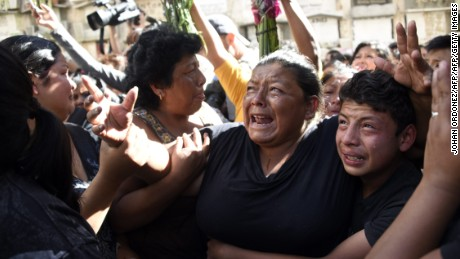 Relatives and friends cry at the funeral of 14-year-old Madelyn Patricia Hernandez Hernandez, who died in a fire at a state-run shelter, at the general cemetery in Guatemala City on March 10, 2017.  Guatemala recoiled in anger and shock at the deaths of at least 36 teenage girls in a fire -19 died immediately and the other 17 died in hospital of horrific burns-  at a government-run shelter where staff has been accused of sexual abuse and other mistreatment. All the victims were aged between 14 and 17. / AFP PHOTO / JOHAN ORDONEZ        (Photo credit should read JOHAN ORDONEZ/AFP/Getty Images)
