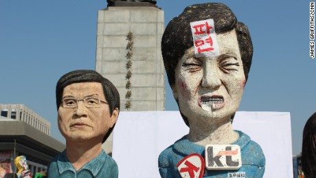 Sculptures depicting ousted South Korean President Park Geun-hye and acting President Hwang Kyo-ahn at a protest camp on Gwanghwamun Square.