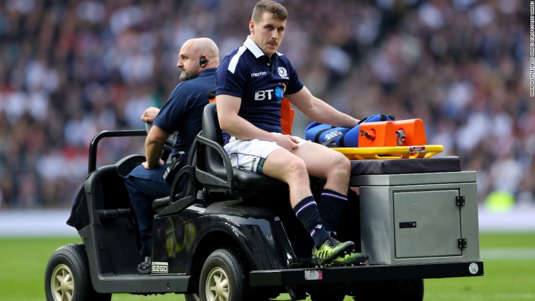 Nothing was going right for Scotland. Mark Bennett is pictured leaving the pitch injured.