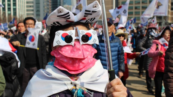"Thousands of South Koreans took to the streets of Seoul Saturday after President Park Geun-hye was officially impeached. While polls suggest most of the country -- as many as 80% -- supports the move, a small minority of demonstrators said they wanted to ""impeach the impeachment."""