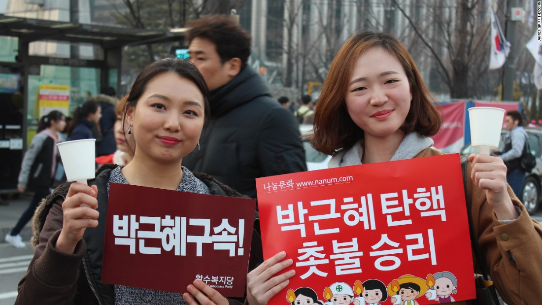 """Today is just the beginning,"" said Kim Ga-hyun, 26 (left). Her friend Kim Bo-hee, 24, said that after months of protests, it was good to have a ""day of celebration."""