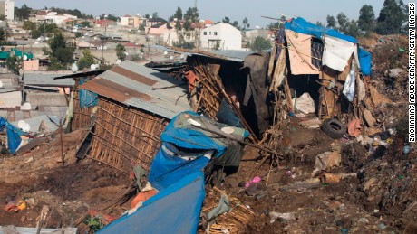 A photo taken on March 12, 2017 shows damaged dwellings after a landslide in the main city dump of Addis Ababa left at least 30 people dead. At least 30 people died and dozens more were hurt in a giant landslide at Ethiopia's largest rubbish dump outside Addis Ababa, a tragedy squatters living there blamed on a biogas plant being built nearby. The landslide saw dozens of homes of people living in the dump levelled after a part of the largest pile of rubbish at the Koshe landfill collapsed, an AFP journalist said.  / AFP PHOTO / ZACHARIAS ABUBEKER        (Photo credit should read ZACHARIAS ABUBEKER/AFP/Getty Images)