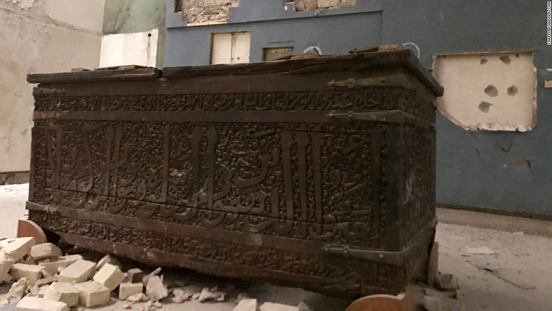An old wooden chest with Arabic writings on it.