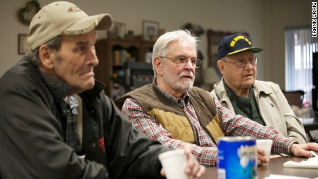 Tom Strohmayer, Rich Grimm and Baci Carpico (from left), retirees in Mingo Junction, Ohio, discuss President Trump at the town's senior center on Tuesday, March 7, 2017.