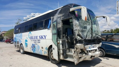 The bus was carrying people to Port Au Prince when it struck pedestrians.