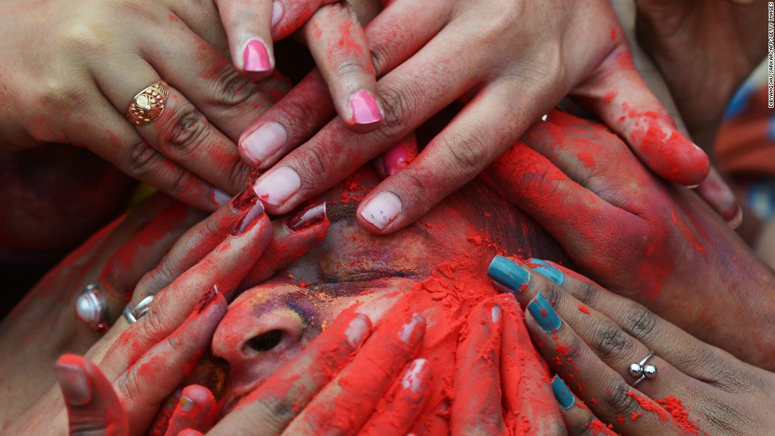 Students in Kolkata, India, smear colored powder at an event to celebrate Holi on Tuesday, March 7.
