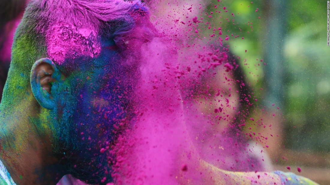 Students play with colored powder in Kolkata on Sunday, March 12.