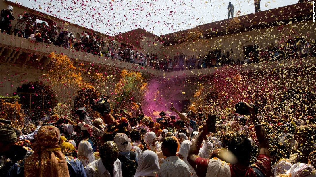 Flower petals and colored powder are thrown at a temple in Vrindavan on Thursday, March 9.