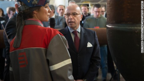 French Prime Minister Bernard Cazeneuve (R) listens to an employee of Clemessy Service, an electrical and mechanical engineering company owned by French construction group Eiffage, during a one-day trip to Vitrolles, southern France, on March 13, 2017. / AFP PHOTO / BERTRAND LANGLOIS        (Photo credit should read BERTRAND LANGLOIS/AFP/Getty Images)