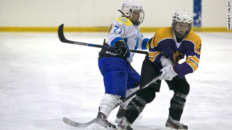 Canadian Kelly Whelan (left) of Kyiv Ukrainochka, vies with Belarussian player Katerina Rudchenko.