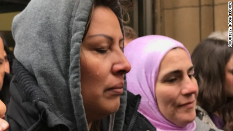 Francisca Lino sheds tears outside ICE headquarters in Chicago.