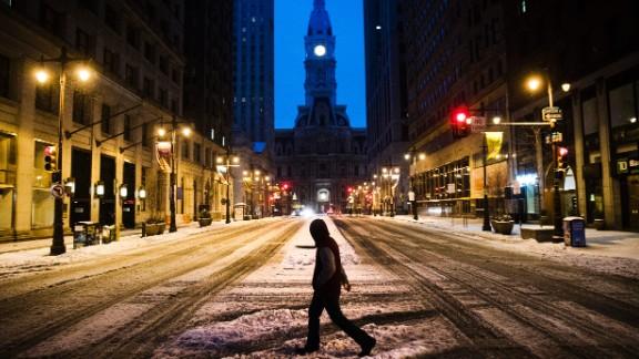 A man crosses South Broad Street in Philadelphia on March 14.