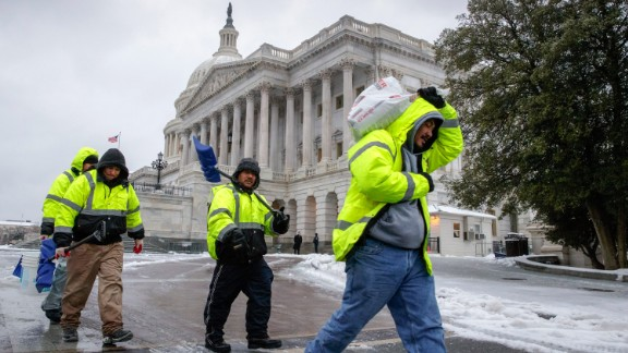 Workers in Washington clear snow on Capitol Hill on March 14.