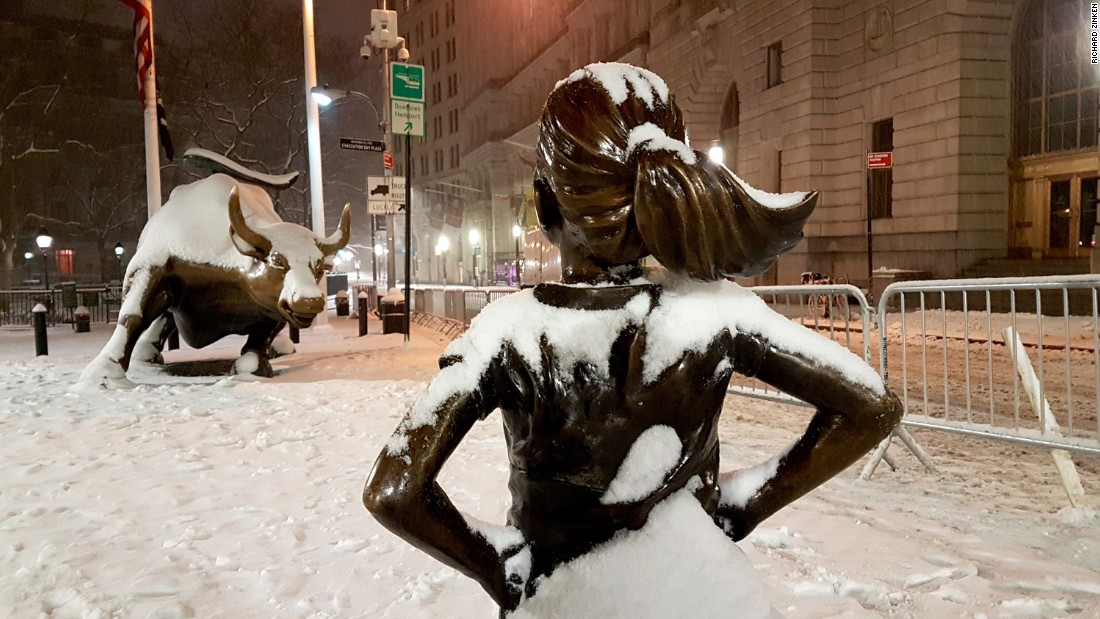 "The ""Fearless Girl"" statue faces Wall Street's charging bull sculpture in New York."