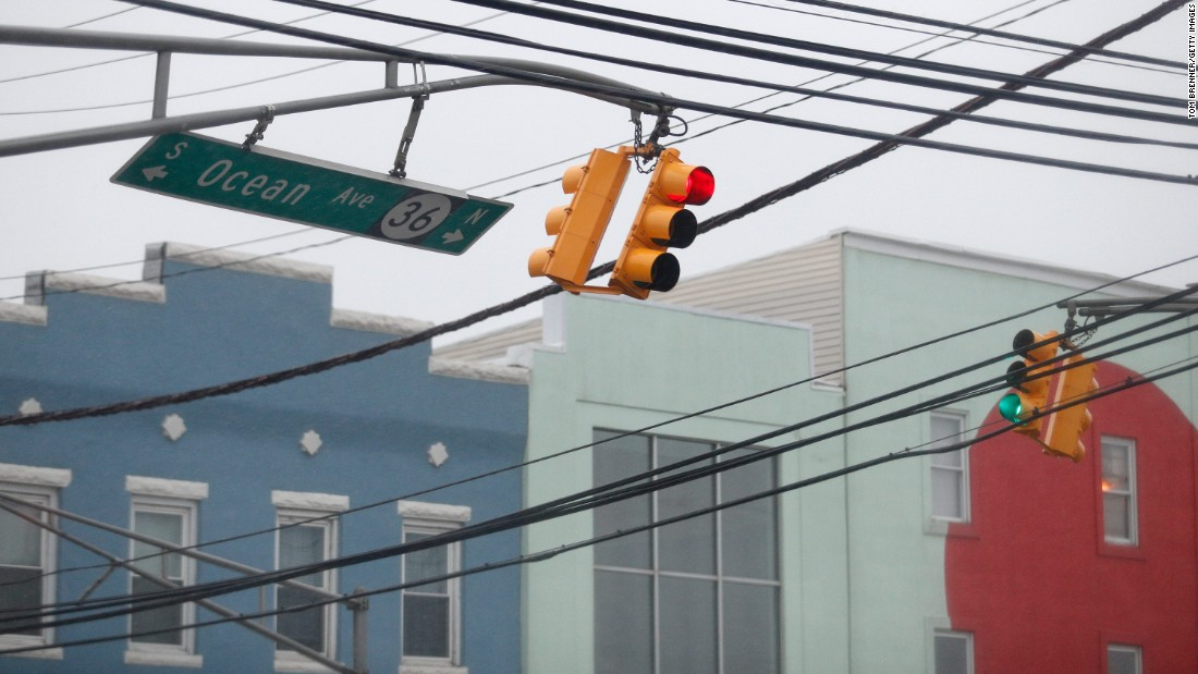 Traffic lights and a street sign sway in heavy winds in Sea Bright, New Jersey, on March 14.