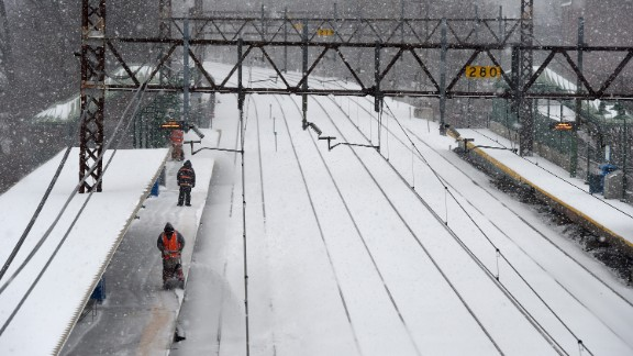 Metro North employees clear the snow off the platform at the Greenwich Station in Greenwich, Connecticut, on March 14.