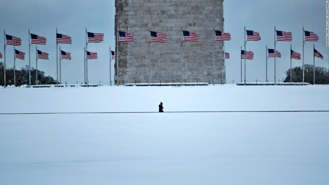 A person walks past the Washington Monument on March 14.