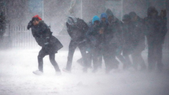 People struggle to walk in Boston on March 14.