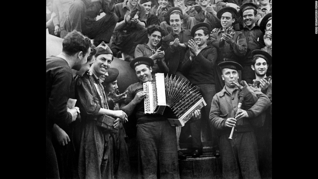 Spanish Marines play musical instruments on a battleship in February 1937.