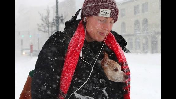 Taryn Hallweaver and her dog, Willy, walk in Portland, Maine, on March 14.