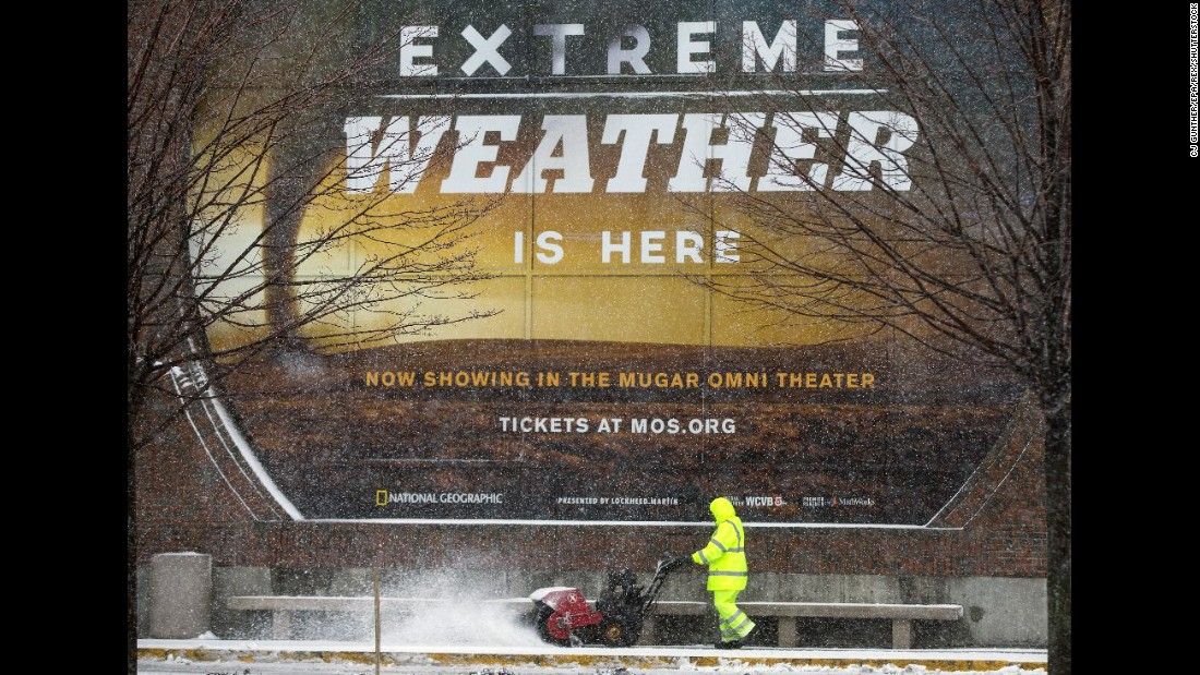 A worker clears the sidewalk in front of Boston's Museum of Science on March 14.