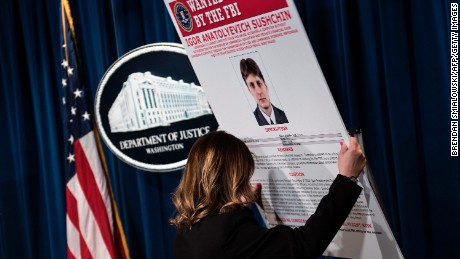 A wanted poster shows Igor Anatolyevich Sushchin, one of three Russians charged in the 2014 hacking of Yahoo.