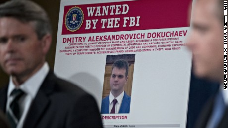 An FBI wanted poster for Dmitry  Dokuchaev at a news conference at the US Department of Justice on March 15.