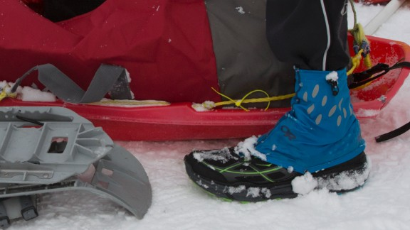 Most runners pull a minimum of 15 pounds of required gear behind them in a sled. The mandatory gear includes a sleeping bag rated minus-20 degrees Fahrenheit, a bivy sack or tent, sleeping pad, and a day's worth of food.