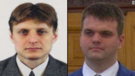 Accused hackers Igor Sushchin, left, and Dmitry  Dokuchaev are officers of the Russian Federal Security Service.