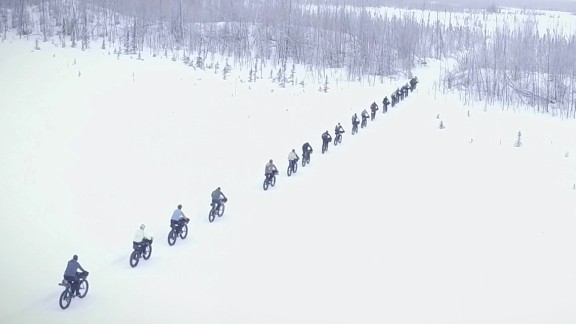 Racers begin down an icy road that turns into a trail that becomes wilderness within the first mile. Soon after that, the pack starts to thin out as bikers pull ahead.