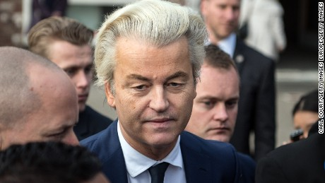 THE HAGUE, NETHERLANDS - MARCH 15:  Geert Wilders (C), the leader of the right-wing Party for Freedom (PVV), speaks to the media after casting his vote during the Dutch general election, on March 15, 2017 in The Hague, Netherlands. Dutch voters go to the polls today in a tightly contested election.  (Photo by Carl Court/Getty Images)