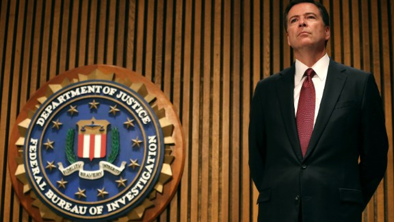 WASHINGTON, DC - JUNE 23:  FBI Director James Comey participates in a news conference on child sex trafficking, at FBI headquarters, June 23, 2014 in Washington, DC. Director Comey said that 168 juveniles have been recovered in a nationwide operation targeting commercial child sex trafficking.  (Photo by Mark Wilson/Getty Images)