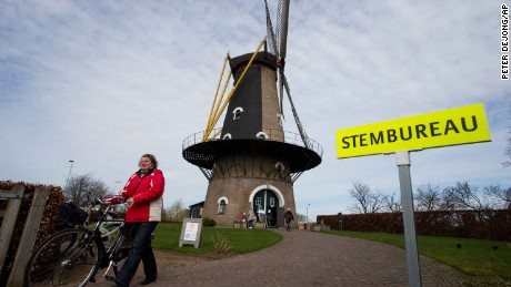 A woman leaves after casting her vote at a windmill turned polling station in Oisterwijk, south central Netherlands on Wednesday.