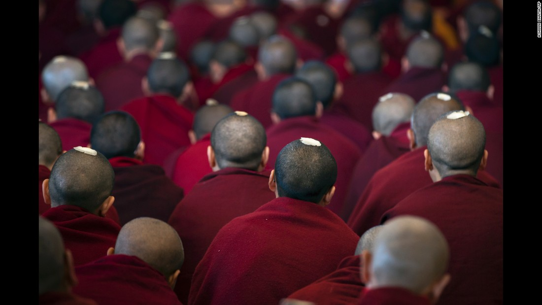 Tibetan monks wear ceremonial seeds on their heads as they listen to the Dalai Lama, their spiritual leader, in Dharamsala, India, on Tuesday, March 14.