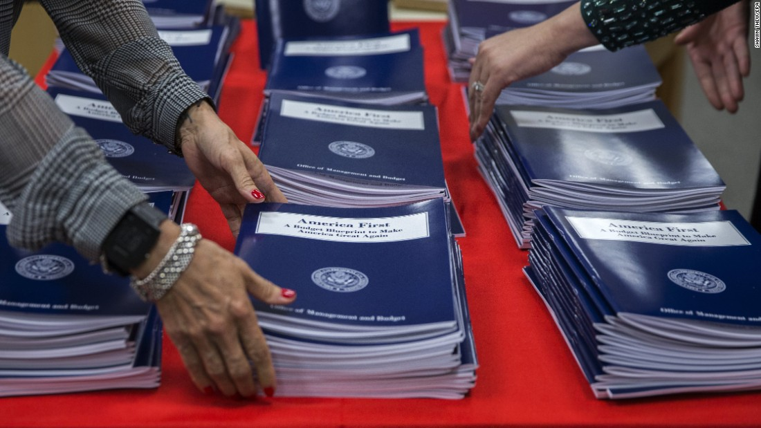 "Copies of ""America First,"" <a href=""http://www.cnn.com/2017/03/16/politics/donald-trump-budget-blueprint/"" target=""_blank"">President Donald Trump's budget proposal,</a> are arranged in Washington on Thursday, March 16. The outline calls for a $54 billion increase in defense spending, and it slashes funding to agencies such as the State Department and the Environmental Protection Agency. <a href=""http://www.cnn.com/2017/03/16/politics/trump-budget-cuts/"" target=""_blank"">Here's what Trump's budget proposes to cut</a>"