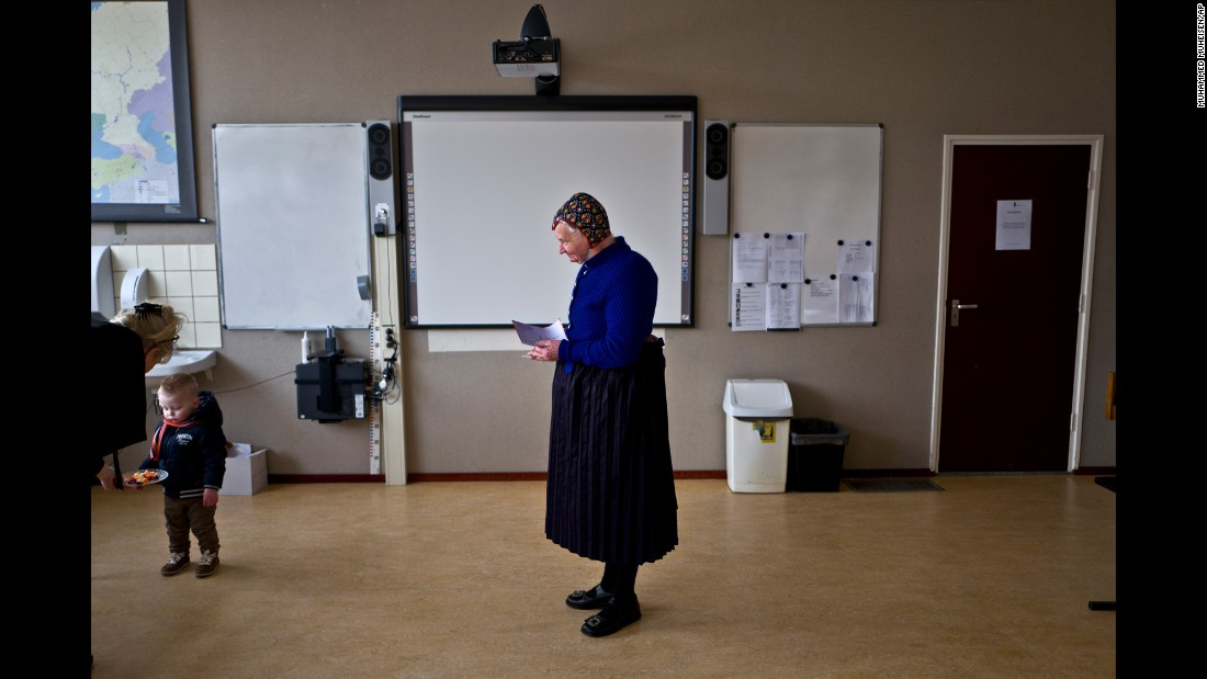 "A woman waits to cast her vote at a school in Staphorst, Netherlands, on Wednesday, March 15. Dutch Prime Minister Mark Rutte staved off a challenge from his far-right rival in an election widely seen as an indicator of populist sentiment in Europe, <a href=""http://www.cnn.com/2017/03/15/europe/netherlands-dutch-elections/"" target=""_blank"">preliminary results indicated.</a>"