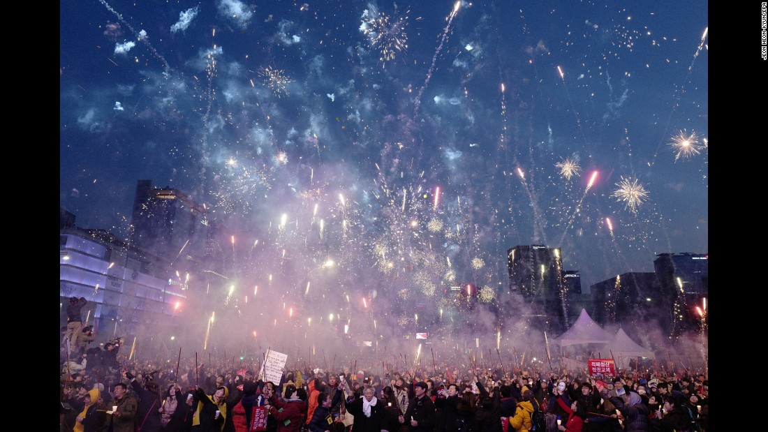 "People in Seoul, South Korea, celebrate with fireworks after the country's Constitutional Court upheld the impeachment of President Park Geun-hye on Friday, March 10. Demonstrators both for and against Park <a href=""http://www.cnn.com/2017/03/10/asia/gallery/park-impeachement-south-korea/index.html"" target=""_blank"">took to the streets</a> after the verdict. <a href=""http://www.cnn.com/2017/03/09/world/gallery/week-in-photos-0310/index.html"" target=""_blank"">See last week in 31 photos</a>"