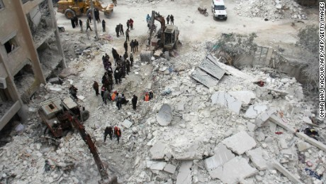 Rescuers search for victims after an air strike in the Syrian city of Idlib on March 15, 2017. Russia has propped up President Bashar al-Assad's with air power.