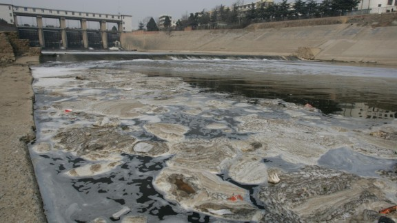 Shaying River, a branch of Huai River (or Huaihe River), is seen seriously polluted in Sunying village, known as the Cancer Village, in Shenqiu county, Zhoukou city, central Chinas Henan province, 2005.