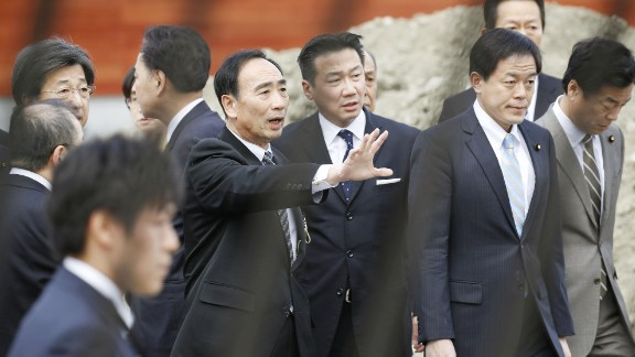 Yasunori Kagoike (center left), the head of Moritomo Gakuen.