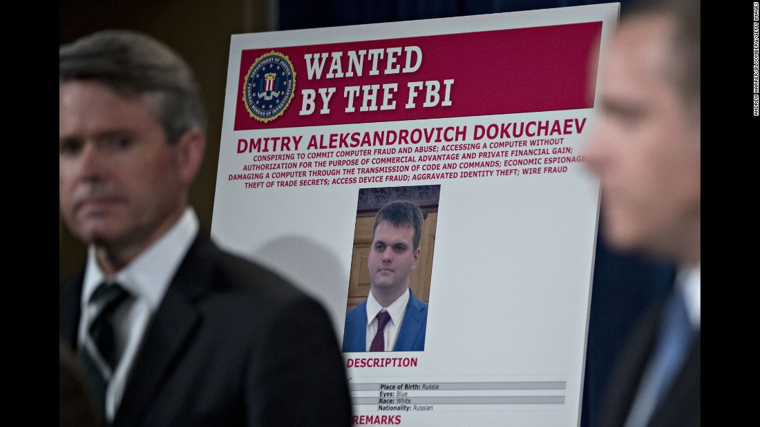 "A wanted poster for Dmitry Dokuchaev is displayed during a Justice Department news conference on Wednesday, March 15. Four people, including two officers of the Russian Federal Security Service (FSB), <a href=""http://www.cnn.com/2017/03/14/politics/justice-yahoo-hack-russia/"" target=""_blank"">have been indicted</a> in connection with a massive hack of the company Yahoo. Dokuchaev was identified as one of the officers of the FSB -- Russia's successor to the Soviet Union's KGB. The hack, which authorities said was initiated in January 2014, affected at least 500 million Yahoo accounts."