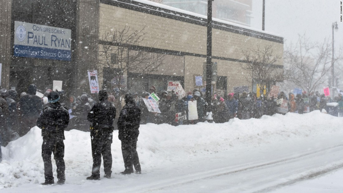 "People in Racine, Wisconsin, protest the Republican health care bill in front of an office of House Speaker Paul Ryan on Tuesday, March 14. The GOP proposal to repeal and replace Obamacare <a href=""http://www.cnn.com/2017/03/16/politics/budget-committee-passes-republican-health-care-plan/index.html"" target=""_blank"">cleared a key procedural hurdle</a> when the House Budget Committee voted in favor of the measure on Thursday, March 16."
